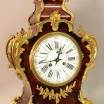 French Louis XV style Tiffany & Co. Bronze Cartel Clock